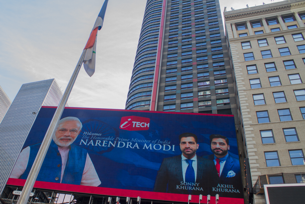 An electronic billboard at Times Square displays Narendra Modi's picture. Photo Credit: Gurman Bhatia/2014.
