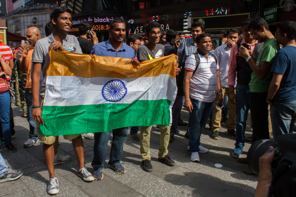 Young Indians pose for a picture with the Indian National flag at Times Square.