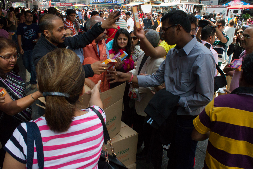 Distribution of packets by Rajbhog Foods. Photo Credit: Gurman Bhatia/2014.